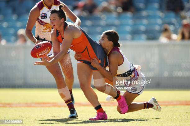 Alyce Parker of the Giants passes as she is tackled during the round six AFLW match between the Greater Western Sydney Giants and the Brisbane Lions...