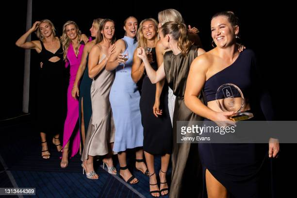 Alyce Parker of the GWS Giants holds her trophy and celebrates with teammates after the NAB AFL Women's All Australian team announcement during the...