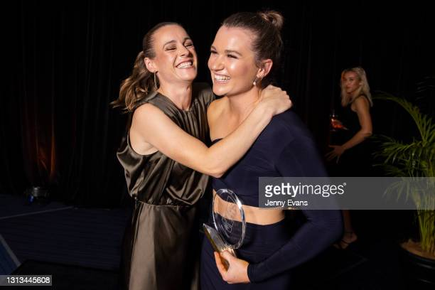 Alyce Parker of the GWS Giants holds her trophy as she is hugged by Alicia Eva after her NAB AFL Women's All Australian team announcement was made...