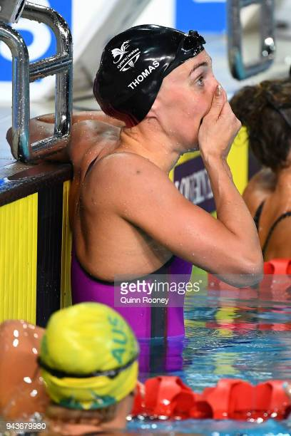Alys Thomas of Wales celebrates victory in the Women's 200m Butterfly Final on day five of the Gold Coast 2018 Commonwealth Games at Optus Aquatic...