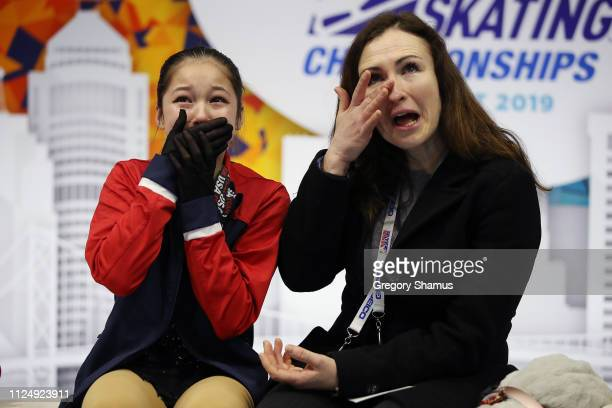 Alysa Liu and her coach Laura Lipetsky react after moving into first place after her Championship Ladies Free Skate during the 2019 Geico US Figure...