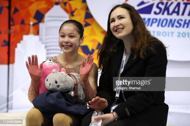 Alysa Liu and her coach Laura Lipetsky wait for her scores after her championship ladies short program during the 2019 Geico US Figure Skating...