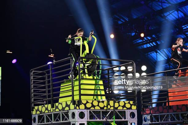 Alysa Liu and Olivia Moultrie participate in a challenge onstage during Nickelodeon Kids' Choice Sports 2019 at Barker Hangar on July 11 2019 in...