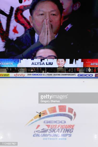 Alysa Liu finishes her Championship Ladies Free Skate while her father Arthur Liu reacts on the jumbotron above the ice during the 2019 US Figure...