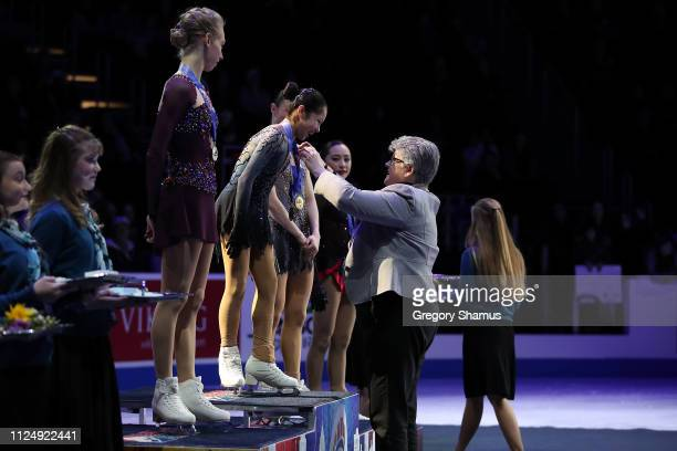 Alysa Liu is presented her gold medal after winning the 2019 Senior Ladies Championship by US Figure Skating president Anne Cammett during the 2019...