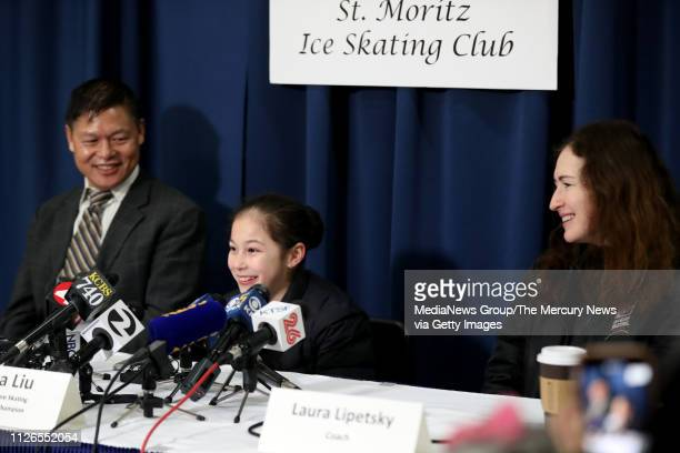 Alysa Liu of Richmond center along with her father Arthur Liu and her coach Laura Lipetsky hold a press conference after practice at Oakland Ice...