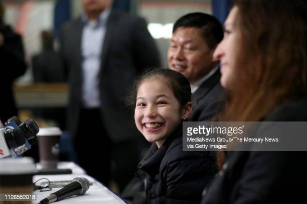 Alysa Liu of Richmond center is all smiles during a press conference along with her father Arthur Liu and her coach Laura Lipetsky after practice at...