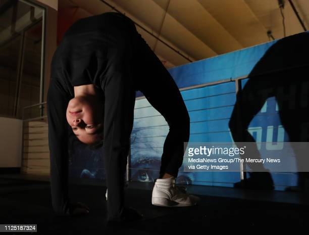 Alysa Liu of Richmond stretches before she practices her technical program with her coach Laura Lipetsky at Oakland Ice Center in Oakland Calif on...
