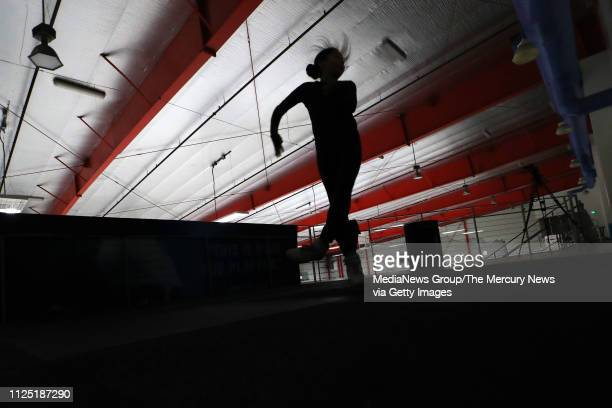 Alysa Liu of Richmond warms up before she practices her technical program with her coach Laura Lipetsky at Oakland Ice Center in Oakland Calif on...