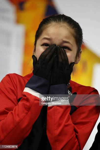 Alysa Liu reacts after moving into first place after her Championship Ladies Free Skate during the 2019 Geico US Figure Skating Championships at...
