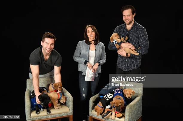 Alyse Barker and Tyler Johnson and Victor Hedman of the Tampa Bay Lightning attend the Players Puppies event at the Grand Hyatt Hotel on January 26...