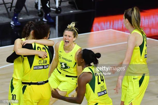 Alysha Clark of the Seattle Storm celebrates with her teammates after scoring a buzzer beater to defeat the Minnesota Lynx 8886 following Game One of...