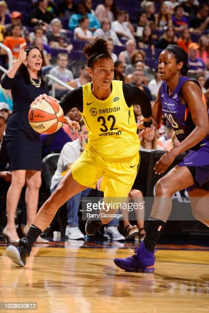 Alysha Clark of the Seattle Storm handles the ball against the Phoenix Mercury on July 31 2018 at Talking Stick Resort Arena in Phoenix Arizona NOTE...