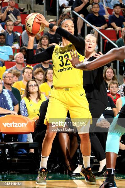 Alysha Clark of the Seattle Storm handles the ball during the game against the New York Liberty on August 17 2018 at Key Arena in Seattle Washington...