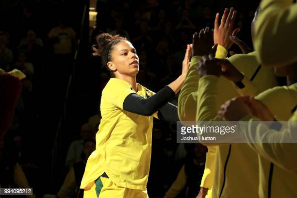 Alysha Clark of the Seattle Storm highfives teammates as she is introduced before the game against the Washington Mystics on July 8 2018 at Key Arena...