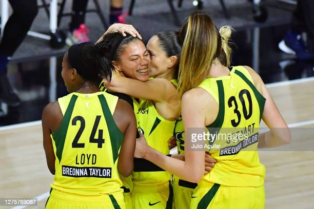 Alysha Clark of the Seattle Storm is surrounded by teammates after scoring a buzzer beater to defeat the Minnesota Lynx 8886 following Game One of...