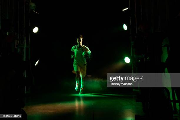 Alysha Clark of the Seattle Storm runs out during team introductions before Game 2 of the WNBA Finals against the Washington Mystics at KeyArena on...