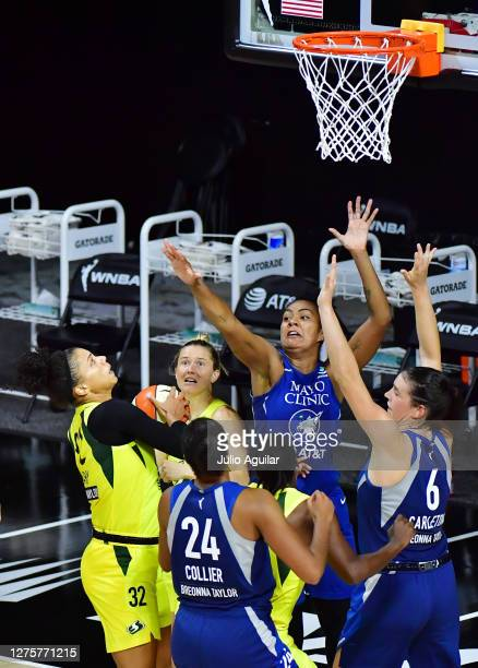 Alysha Clark of the Seattle Storm scores a buzzer beater to defeat the Minnesota Lynx 8886 following Game One of their Third Round playoff at Feld...