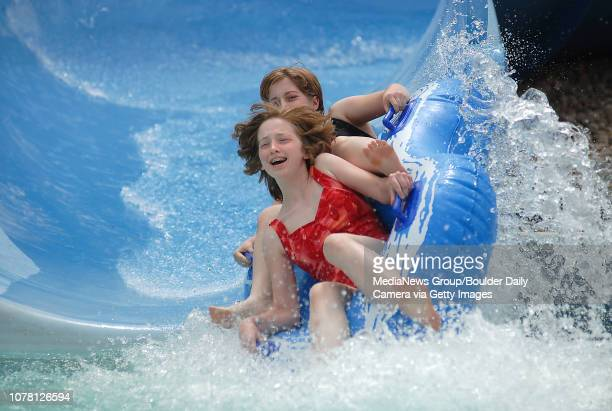 Alysha Clarke front and her sister Brenna Clarkemake a big splash at the end of the big blue slide at The Bay on Monday May 28 2007 Photo/David R...