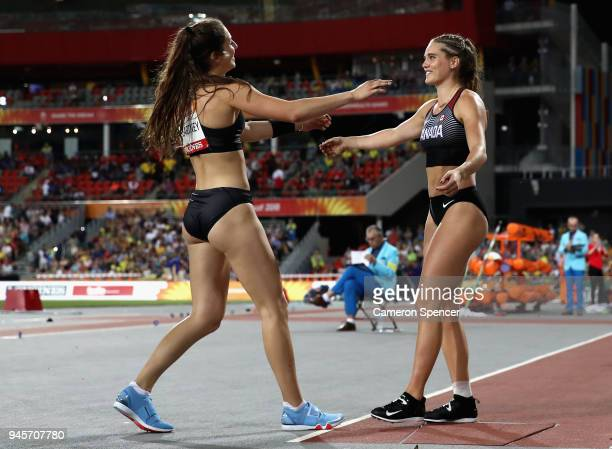 Alysha Newman of Canada celebrates winning gold with silver medalist Eliza McCartney of New Zealand in the Women's Pole Vault during athletics on day...
