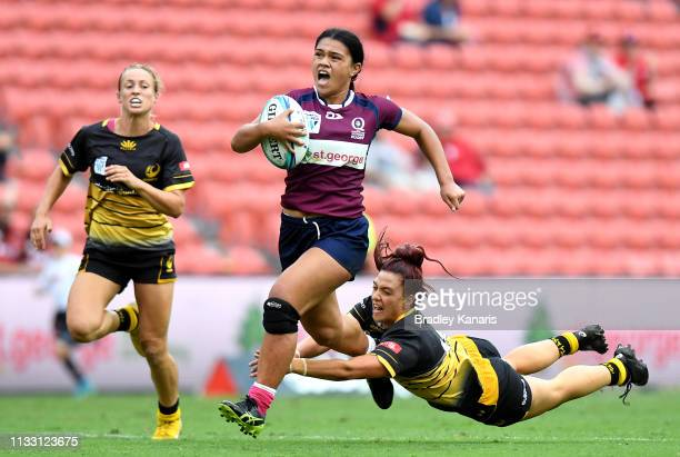 Alysia LefauFakaosilea of Queensland breaks away from the defence during the round two SuperW Rugby match between Queensland and Western Australia at...