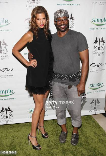 Alysia Reiner and Byron Lars attends the Simple Skincare Caravan Stylist Studio Fashion Week Event on September 7 2014 in New York City