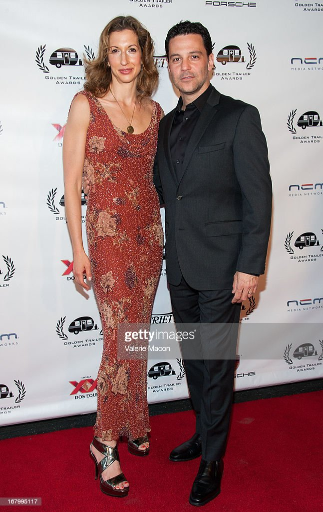 Alysia Reiner and David Alan Basche arrive at the 14th Annual Golden Trailer Award at Saban Theatre on May 3, 2013 in Beverly Hills, California.