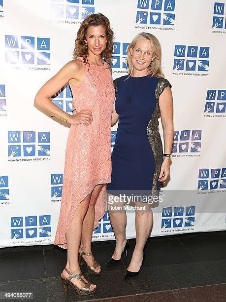 Alysia Reiner and Piper Kerman attend the 2014 Annual Benefit by the Women's Prison Association at Loeb Central Park Boathouse on May 27 2014 in New...