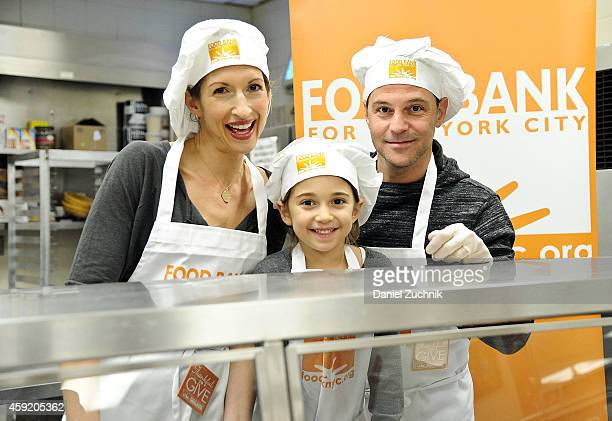 Alysia Reiner David Alan Basche and Livia Basche attend the Food Bank For New York City's 'Thankful To Give' Holiday Campaign at Food Bank for New...