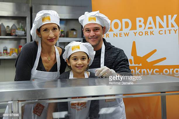 Alysia Reiner Livia Basche and David Alan Basche attend the Food Bank For New York City's Thankful To Give Holiday Campaign at Food Bank for New York...