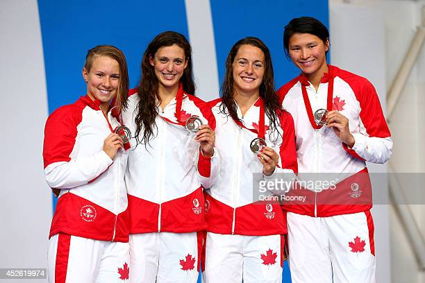 Alyson Ackman Michelle Williams Sandrine Mainville and Victoria Poon of Canada pose with their bronze medals during the medal ceremony for the...