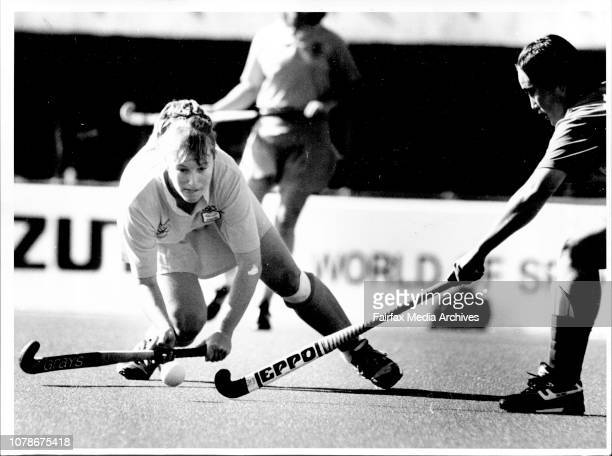 Alyson Annan is a picture of concentration for Australia as she puts Australia on the attack against Korea yesterdayCentre forward Lisa Powell scored...