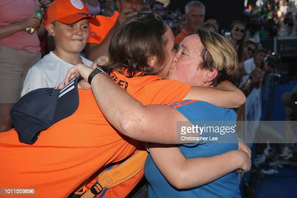 Alyson Annan of Netherlands celebrates their victory with family members during the Final game between Netherlands and Ireland of the FIH Womens...