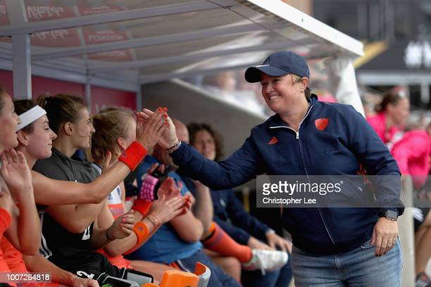 Alyson Annan of Netherlands high fives with her players during the Pool A game between Netherlands and Italy of the FIH Womens Hockey World Cup at...