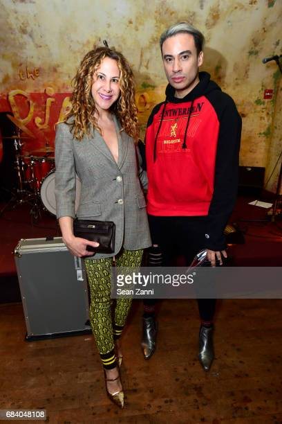 Alyson Cafiero and Victor de Souza attend AS IF Magazine and Tommy Hilfiger celebrates issue 11 and honors Mick Rock at The Roxy Hotel on May 16 2017...