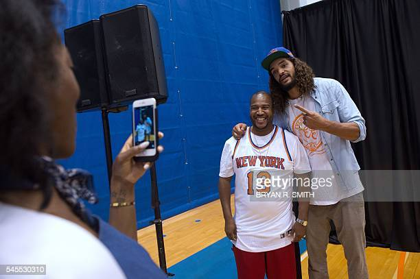 Alyson Furch takes a photograph of Cobe Williams with the New York Knicks' newest player Joakim Noah at at Madison Square Garden training center on...