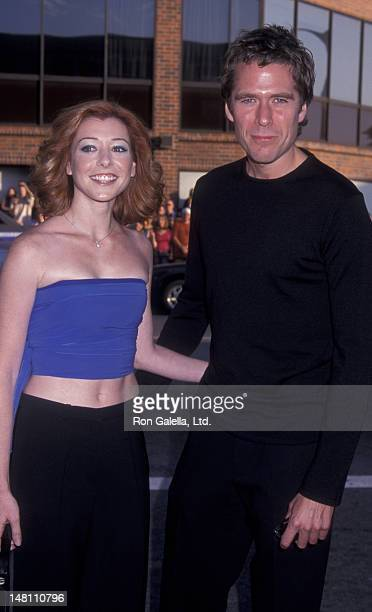 Alyson Hannigan and Alexis Denisof attend the world premiere of 'American Pie 2' on August 6 2001 at Mann National Theater in Westwood California