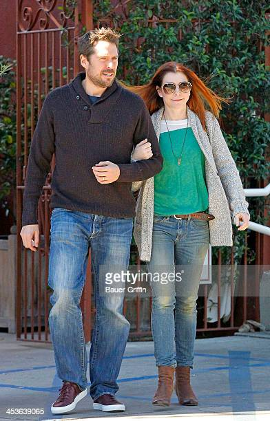Alyson Hannigan and her husband Alexis Denisof are seen at the Brentwood Country Mart on December 04 2013 in Los Angeles California