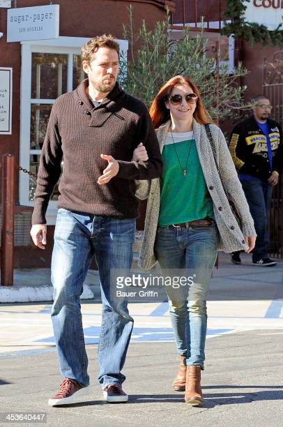 Alyson Hannigan and her husband Alexis Denisof are seen shopping on December 04 2013 in Los Angeles California