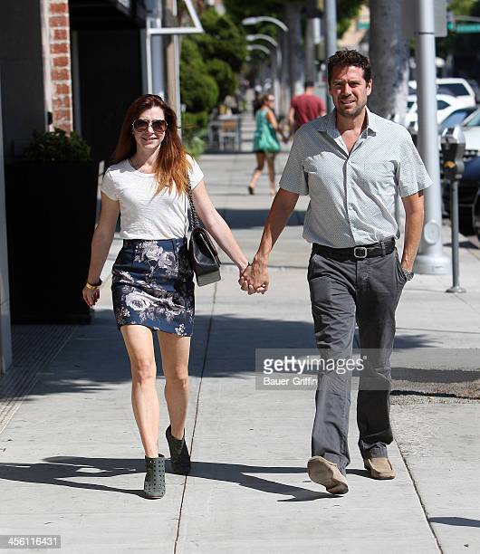 Alyson Hannigan and husband Alexis Denisof in Beverly Hills on September 14 2013 in Los Angeles California