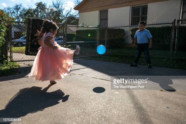Alyson kicks a ball to her brother Axel 7 Minerva Cisneros's surviving children live with their grandparents in Fort Worth CREDIT Ilana PanichLinsman...