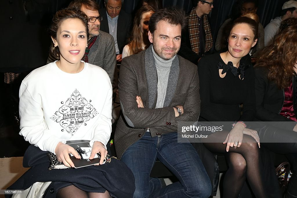 Alyson Paradis, Clovis Cornillac and Lilou Fogli attend the Alexis Mabille Fall/Winter 2013 Ready-to-Wear show as part of Paris Fashion Week on February 27, 2013 in Paris, France.