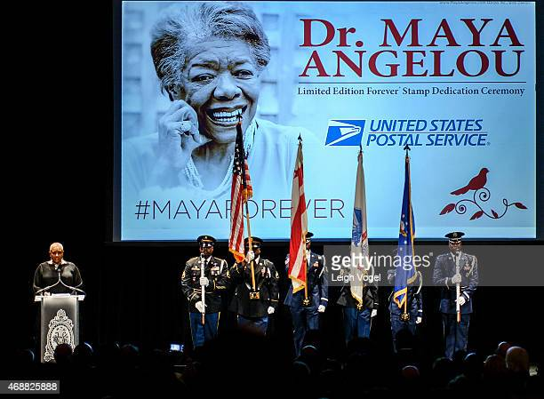 Alyson Williams performs The National Anthem during the Maya Angelou Forever Stamp Dedication at Warner Theatre on April 7 2015 in Washington DC