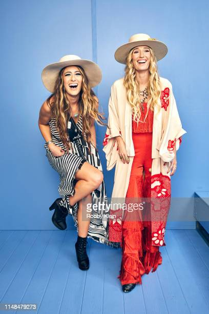 Alyssa Bonagura and Ruby Stewart of The Sisterhood Band pose for a portrait during the 2019 CMT Music Awards at Bridgestone Arena on June 5 2019 in...