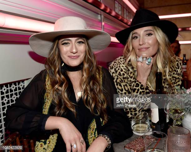 Alyssa Bonagura and Ruby Stewart of The Sisterhood take photos during the 2018 CMT Artists of The Year at Schermerhorn Symphony Center on October 17...