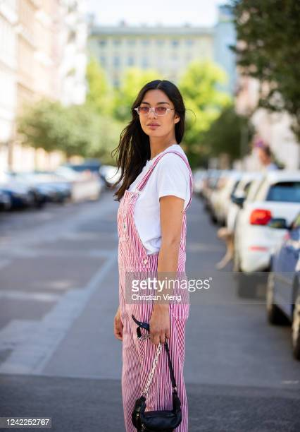 Alyssa Cordes is seen wearing red striped Carhartt overall white tshirt Riani black other stories bag on June 02 2020 in Berlin Germany