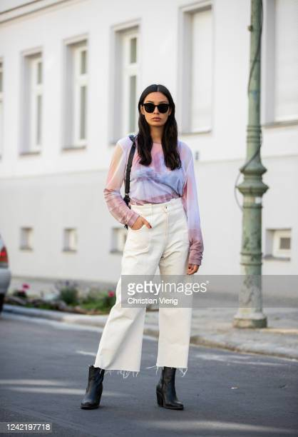 Alyssa Cordes is seen wearing sheer top and cropped wide leg pants in beige Our Legacy, black Mango ankle boots, black bag &Other Stories on June 02,...