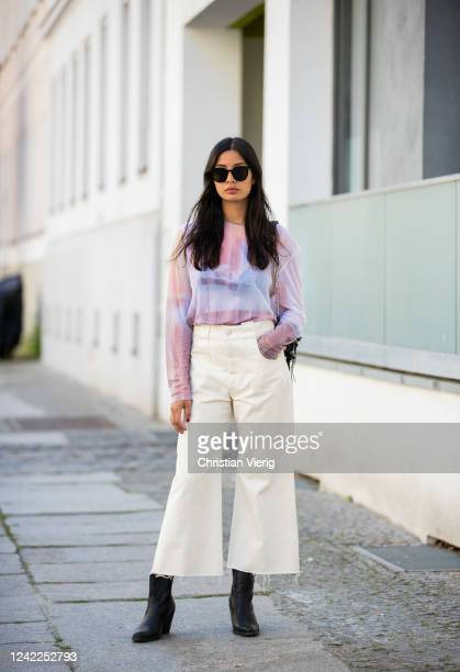 Alyssa Cordes is seen wearing sheer top and cropped wide leg pants in beige Our Legacy black Mango ankle boots black bag Other Stories on June 02...