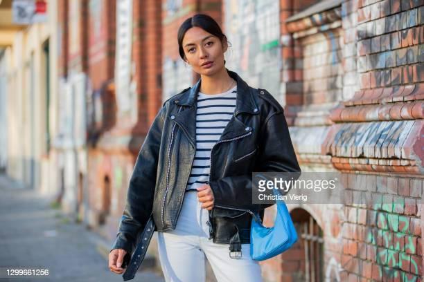 Alyssa Cordes is seen wearing white pants Levis, turquoise bag Prada, striped top vintage Jean Paul Gaultier, black leather jacket vintage on January...