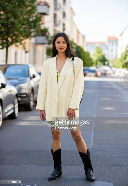 Alyssa Cordes is seen wearing yellow vintage blazer and black cowboy boots, Lala Berlin dress with print, &other stories bag on June 02, 2020 in...